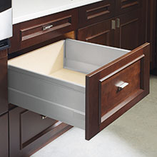 Cabinet drawer open to show metal box