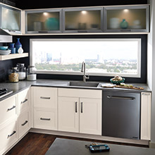 Elan kitchen with timeless design elements, like the frosted glass inserts