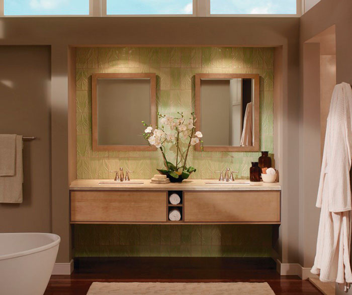 Light maple cabinets in contemporary bathroom by Kitchen Craft Cabinetry