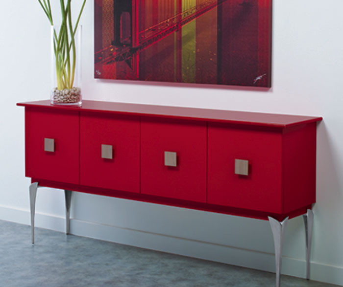 Red cabinet as a credenza by Kitchen Craft Cabinetry