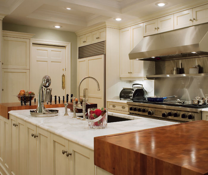 Painted cabinets in casual kitchen by Kitchen Craft Cabinetry