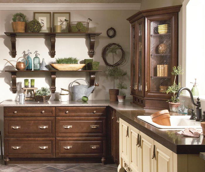 Maple cabinets in potting room by Kitchen Craft Cabinetry