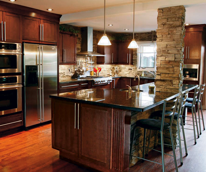 Dark cherry cabinets in casual kitchen by Kitchen Craft Cabinetry