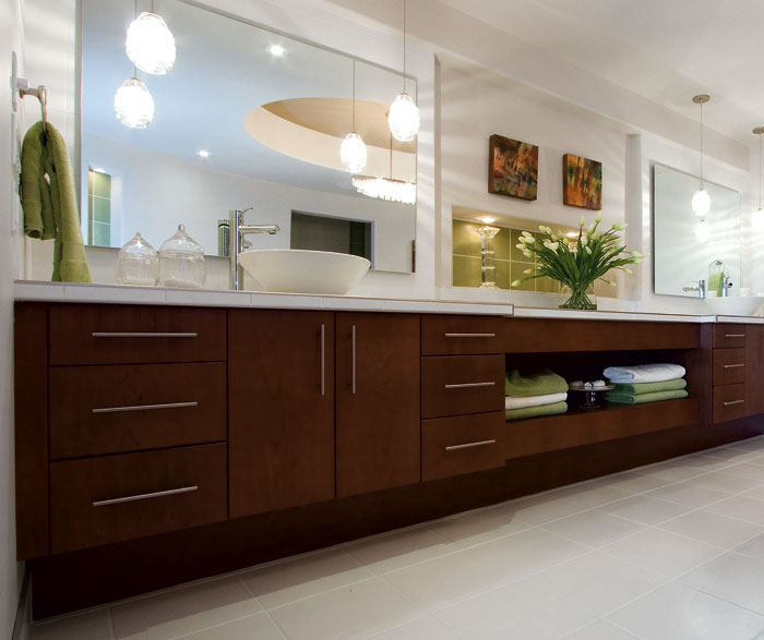 Contemporary cherry bathroom cabinets by Kitchen Craft Cabinetry