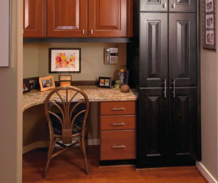 Cherry wood kitchen with charcoal maple accents by Kitchen Craft Cabinetry