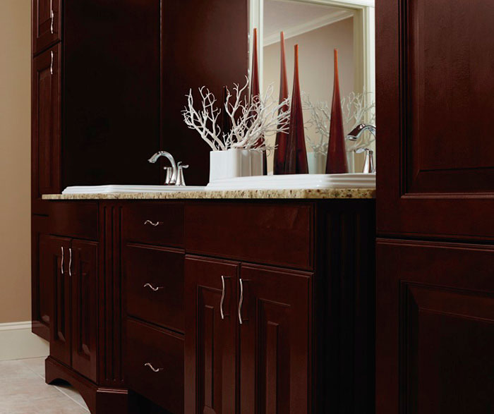 Espresso cabinets in casual bathroom by Kitchen Craft Cabinetry