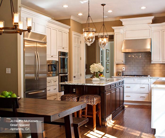 Off white glazed cabinets with a dark kitchen island