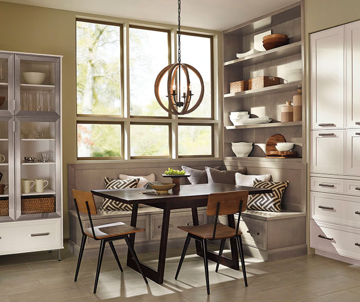 Dining area of casual open kitchen design by Kitchen Craft Cabinetry