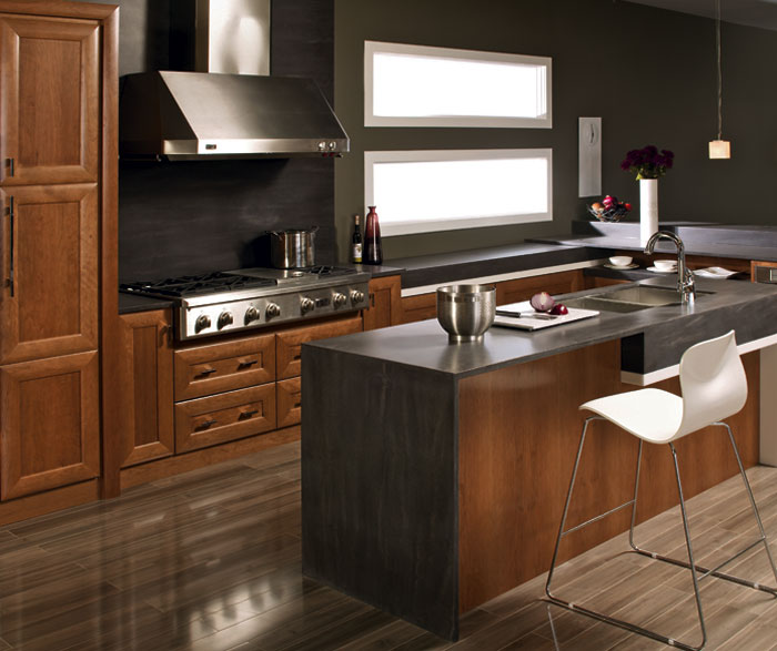 Contemporary kitchen with cherry cabinets by Kitchen Craft Cabinetry
