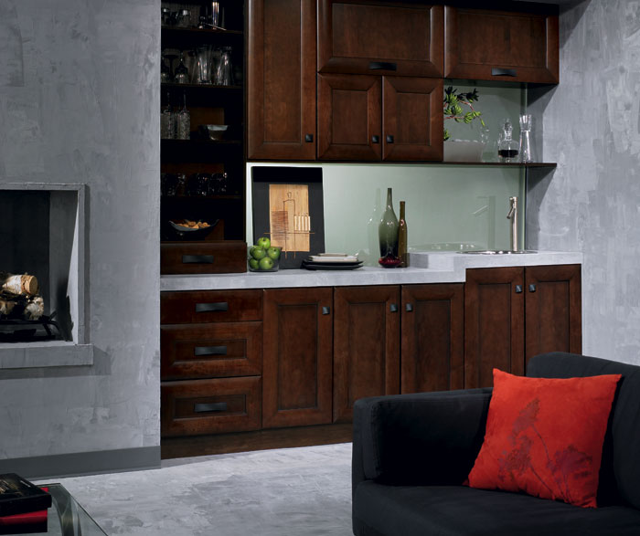 Maple cabinets in contemporary bar area by Kitchen Craft Cabinetry