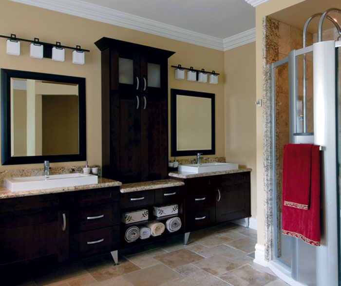 Espresso shaker cabinets in contemporary bathroom by Kitchen Craft Cabinetry