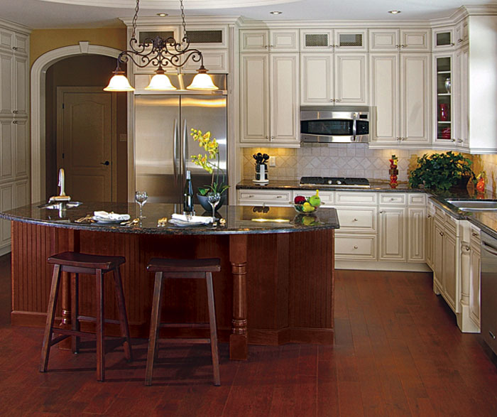 Painted maple cabinets with cherry kitchen island by Kitchen Craft Cabinetry