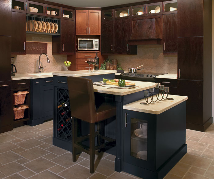 Oak kitchen cabinets with blue accents by Kitchen Craft Cabinetry