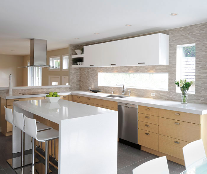 White oak kitchen cabinets with gloss white accents by Kitchen Craft Cabinetry