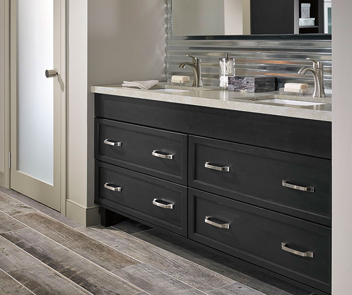 Dark gray cabinets in a casual bathroom by Kitchen Craft Cabinetry